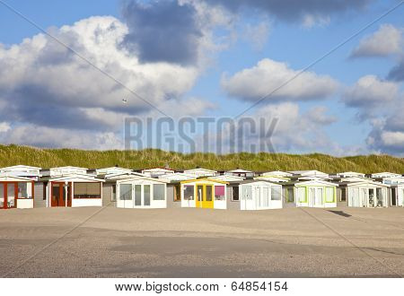 View of Dutch Beach Houses With Cloudy Sky