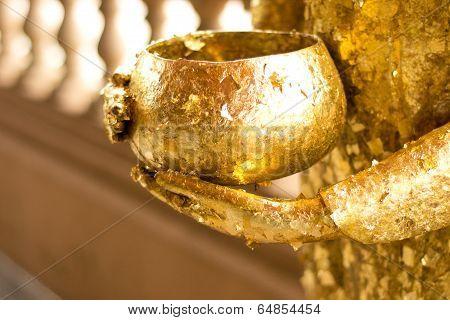 Buddha statue holding bowl