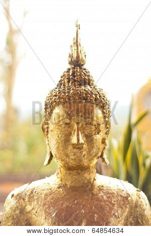 The Buddha statue with gold leaf