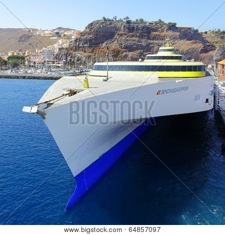 SAN SEBASTIAN DE LA GOMERA, SPAIN - JULY 16, 2013: Benchijigua Express ferry boat on the berth