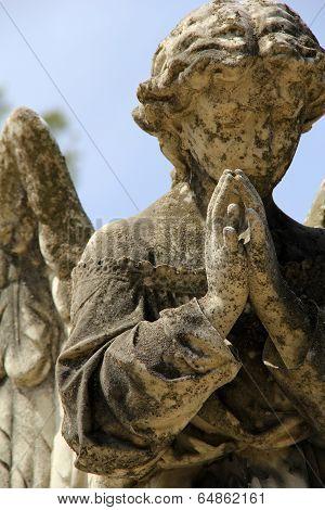 Statue of angel in graveyard