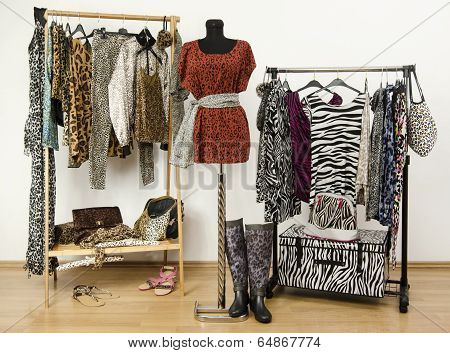 Dressing closet with animal print clothes arranged on hangers.