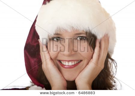 Young Attractive Woman With Santa Claus Christmas Fur Cap Holds Face