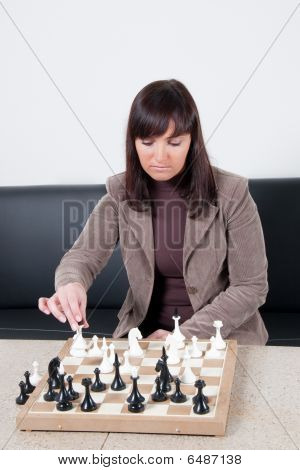 Businesswoman Playing Chess