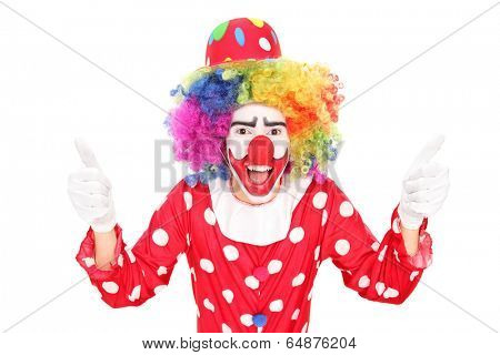 Excited clown giving thumbs up isolated against white background