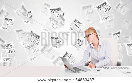 Business woman at desk with stock market newspapers concept