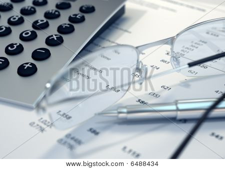 Calculator, pen, glasses