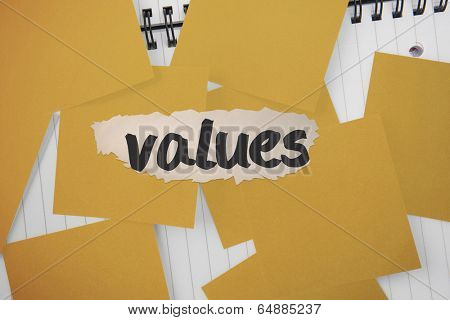 The word values against yellow paper strewn over notepad
