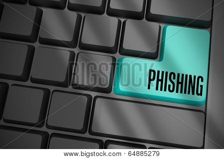 The word phishing on black keyboard with blue key