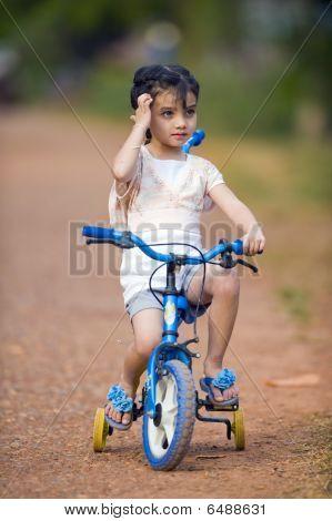 Pretty Thai-indian Girl On Her Bike