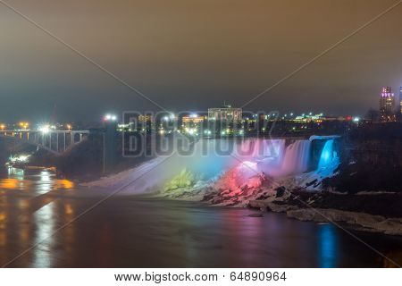 Illumination light of american Falls as viewed from Table Rock in Queen Victoria Park in Niagara Falls at night, Ontario, Canada