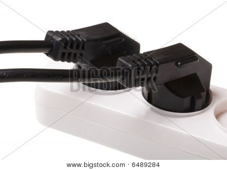 Power Cord In Outlet Isolated On White Background