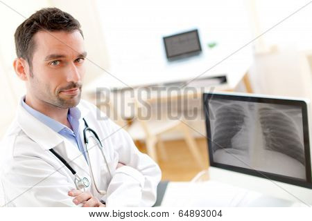 Portrait Of A Young Doctor Analysing A Radiography