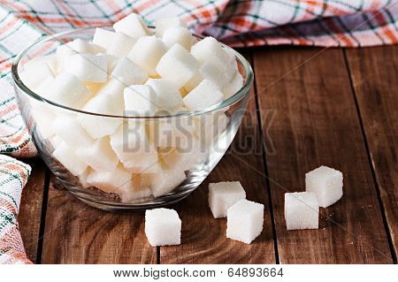 Sugar On Wooden Background
