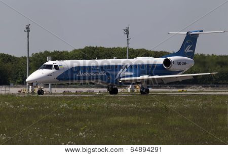 Dniproavia Airlines Embraer ERJ-145LR aircraft preparing for take-off from the runway
