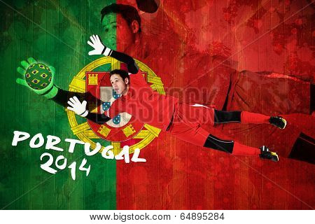 Fit goal keeper jumping up against portugal flag in grunge effect