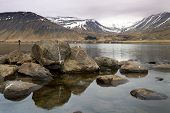 pic of early spring  - Fishing in a calm lake early in the spring - JPG