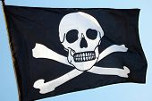 stock photo of skull crossbones flag  - Pirate flag of skull and crossbones - JPG