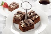 pic of cake stand  - chocolate cake on a cake stand and some coffee