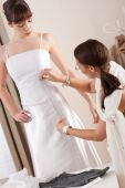 pic of tailoring  - Fashion model fitting white wedding dress in professional fashion designer studio - JPG