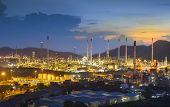 image of refinery  - Oil refinery at twilight with sky background - JPG