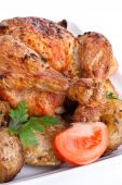 foto of roast chicken  - whole golden roasted chicken with roasted potatoes - JPG