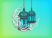 pic of crescent-shaped  - Arabic islamic calligraphy of text Ramadan Kareem and Ramazan Kareem in crescent moon shape with intricate lamps and lanterns on shiny green and blue background - JPG