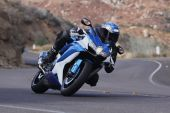 stock photo of crotch-rocket  - High speed motorcycle sportbike on mountain road - JPG
