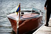 stock photo of dock a lake  - A docked wooden motor boat - JPG
