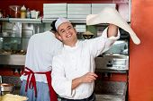 foto of chef cap  - Chef makes the pizza dough spin in the air - JPG