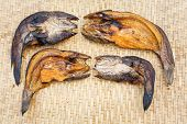 image of snakehead  - Close up Crispy smoke dried striped snakehead fish on bamboo threshing basket - JPG