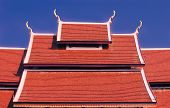 stock photo of red roof tile  - The red tile roof in nature daytime in Asia - JPG