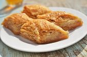 picture of baklava  - Turkish sweet pastry baklava on a plate closeup - JPG