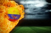 image of football pitch  - Composite image of fire surrounding colombia flag football against football pitch under stormy sky - JPG