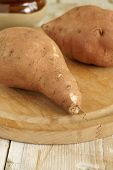 stock photo of ipomoea  - Sweet Potatoes or Ipomoea batatas are sweet tasting tuberous roots and a major food source - JPG