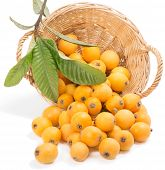 stock photo of loquat  - loquats with leaves in a basket is scattered isolated on a on white - JPG