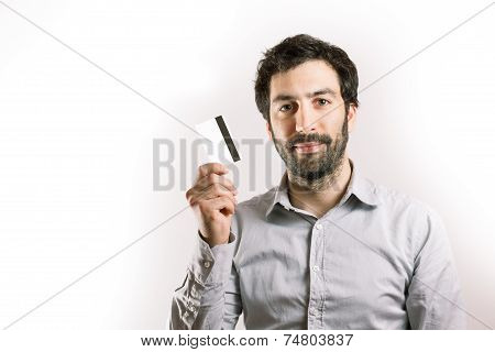 positive young man holding a credit card