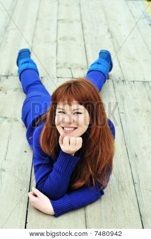Redheaded Girl Wearing Blue Clothes