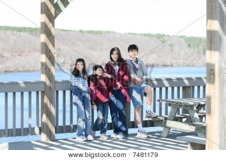 Four Children On Deck By River
