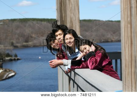 Four Children On Outdoor Deck
