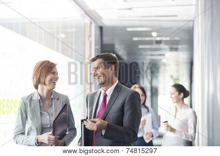 Business people walking in corridor