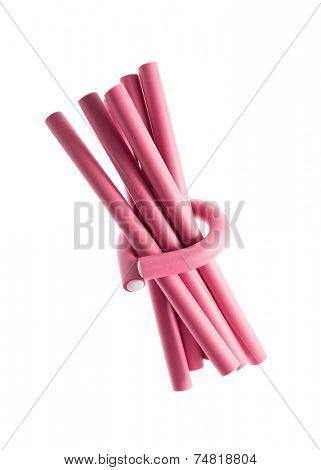 Pink hair curlers on a white background