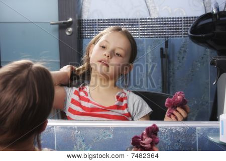 Girl Preening At Mirror