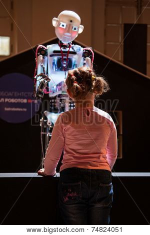 MOSCOW - OCTOBER 15: Robot and unknown guest during First Moscow International Forum - Culture. Look into the future on October 15, 2014 in Moscow, Russia.