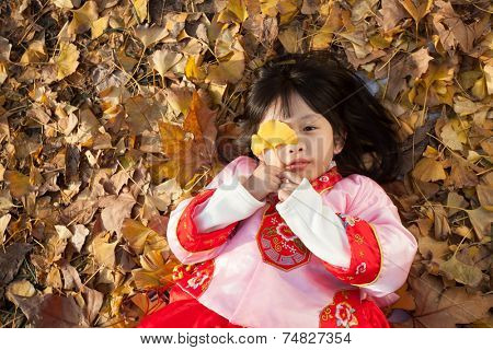 little girl dress in new year  costume and enjoy forest