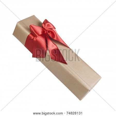 Christmas present with a beautiful red bow on white background