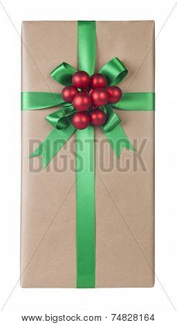 Christmas present with a beautiful green bow and decoration on white background