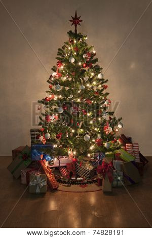 Beautiful christmas tree with lights and presents