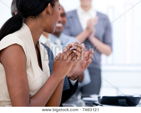 Happy Business Team Applauding In A Meeting