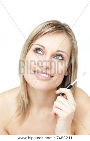 Portrait Of A Blond Woman Holding A Lipstick